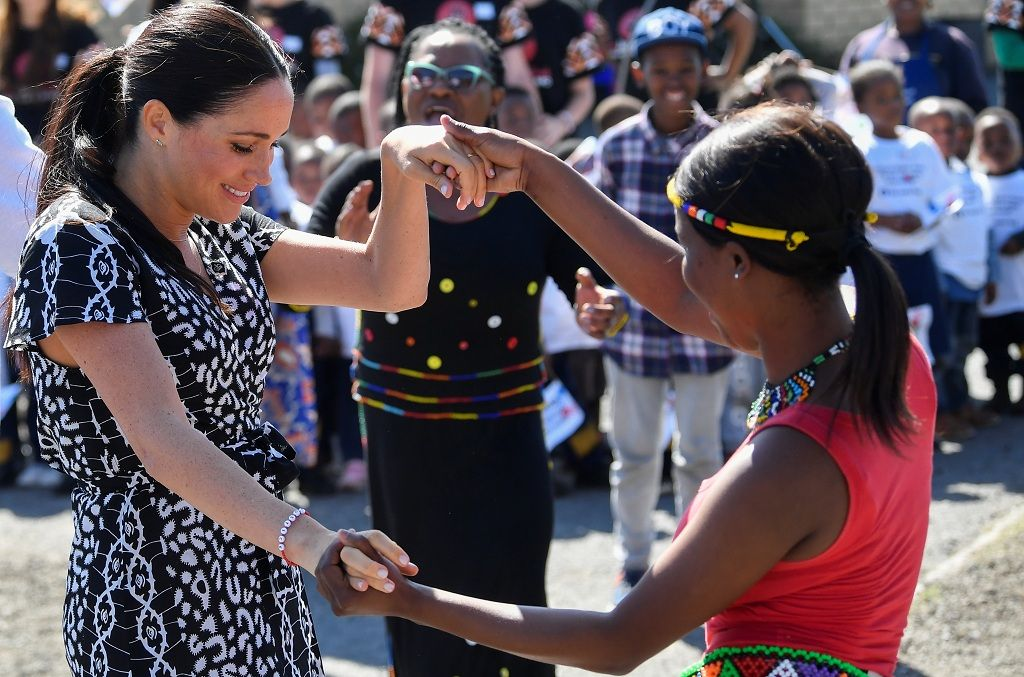The Duchess of Sussex, Meghan, dances during a Justice Desk initiative in Nyanga township, on the first day of her African tour in Cape Town, South Africa, September 23, 2019. REUTERS/Toby Melville