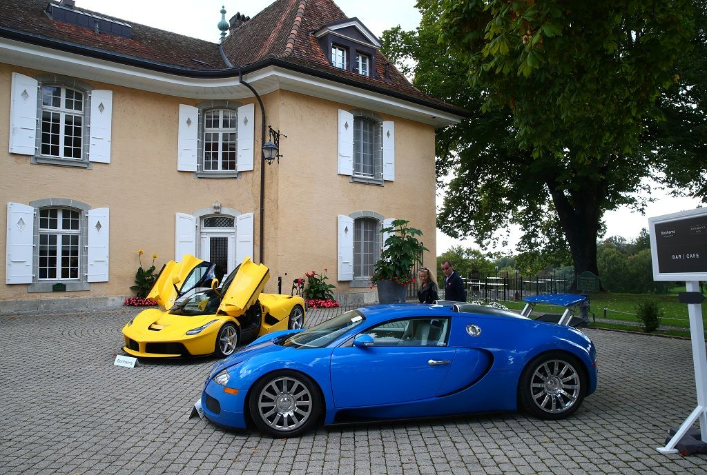 A Ferrari LaFerrari (2015) and a Bugatti Veyron EB 16.4 Coupe (2010), part of some 25 luxury cars owned by Teodoro Obiang, the son of the Equatorial Guinea's President Teodoro Obiang Nguema Mbasogo and confiscated by the Geneva prosecutorÕs office after a deal ending a money-laundering inquiry, are pictured during an auction preview of Bonhams at the Bonmont Golf & Country Club in Cheserex near Geneva, Switzerland September 27, 2019. REUTERS/Denis Balibouse
