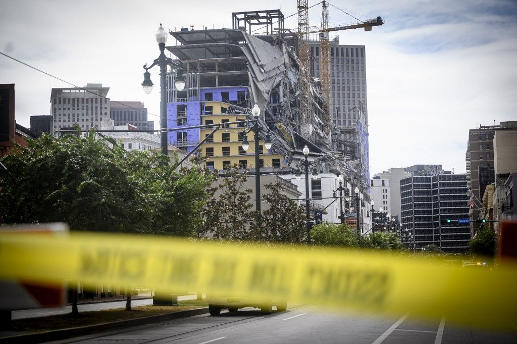 The Hard Rock Hotel partially collapsed onto Canal Street downtown New Orleans, Louisiana on October 12, 2019. - One person died and at least 18 others were injured Saturday when the top floors of a New Orleans hotel that was under construction collapsed, officials said. The New Orleans fire department received reports at 9:12am local time that the Hard Rock Hotel in downtown New Orleans had collapsed. (Photo by Emily Kask / 30238387A / AFP)