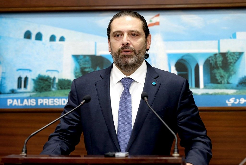 A handout picture provided by the Lebanese photo agency Dalati and Nohra shows Lebanon's Prime Minister Saad Hariri speaking to the press following a cabinet meeting at the presidential palace in Baabda, east of the capital Beirut on October 21, 2019. - Hariri said,  in the face of growing anti-government protests that he supported demonstrators' call for early elections. A proposed tax on mobile messaging applications last week sparked a spontaneous, cross-sectarian mobilisation that has brought Lebanon to a standstill and put the entire political class in the dock. (Photo by STRINGER / DALATI AND NOHRA / AFP) / === RESTRICTED TO EDITORIAL USE - MANDATORY CREDIT