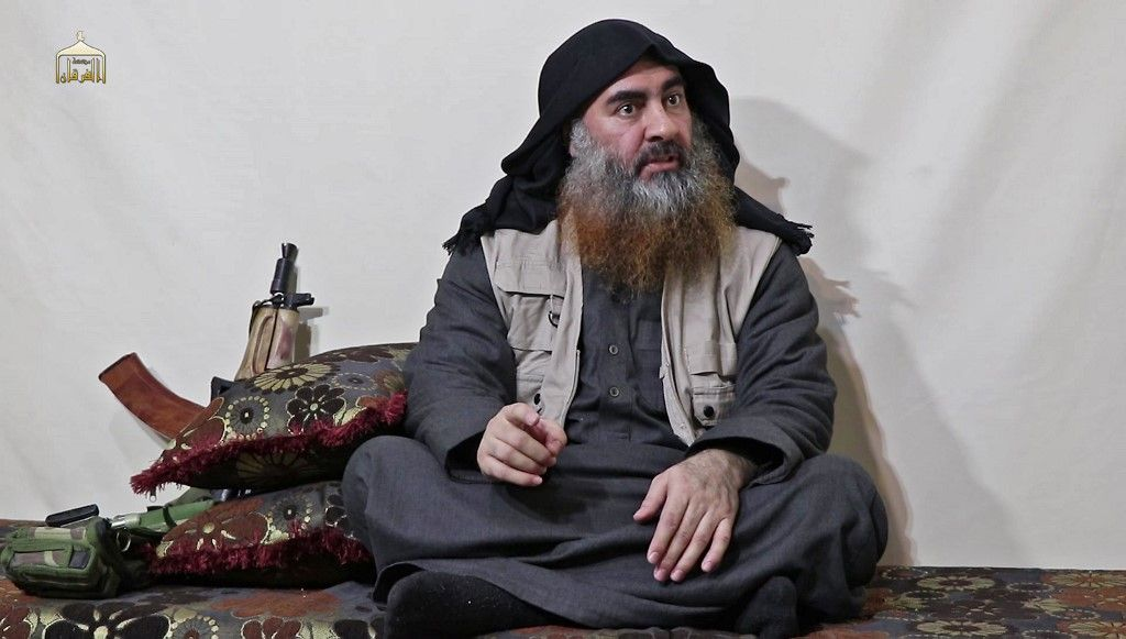 "(FILES) In this undated filer image grab taken from a video released by Al-Furqan media on April 29, 2019, the chief of the Islamic State group Abu Bakr al-Baghdadi purportedly appears for the first time in five years in a propaganda video in an undisclosed location. - Baghdadi was believed to be dead after a US military raid in Syria's Idlib region, US media reported early Sunday. Baghdadi may have killed himself with a suicide vest as US special operations forces attacked, media said citing multiple government sources. (Photo by - / AL-FURQAN MEDIA / AFP) / THIS PICTURE WAS MADE AVAILABLE BY A THIRD PARTY. AFP CAN NOT INDEPENDENTLY VERIFY THE AUTHENTICITY, LOCATION, DATE AND CONTENT OF THIS IMAGE. THIS PHOTO IS DISTRIBUTED EXACTLY AS RECEIVED BY AFP. RESTRICTED TO EDITORIAL USE - MANDATORY CREDIT ""AFP PHOTO / SOURCE / AL-FURQAN"" - NO MARKETING - NO ADVERTISING CAMPAIGNS - DISTRIBUTED AS A SERVICE TO CLIENTS /"