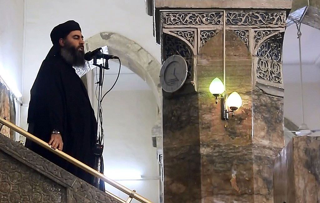 MOSUL, IRAQ - JULY 5 : An image grab taken from a video released on July 5, 2014 by Al-Furqan Media shows alleged Islamic State of Iraq and the Levant (ISIL) leader Abu Bakr al-Baghdadi preaching during Friday prayer at a mosque in Mosul.(Photo by Al-Furqan Media/Anadolu Agency/Getty Images)